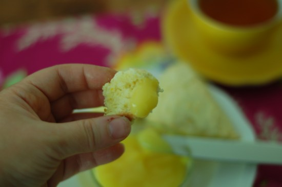 14. Bite of orange scone with tropical curd
