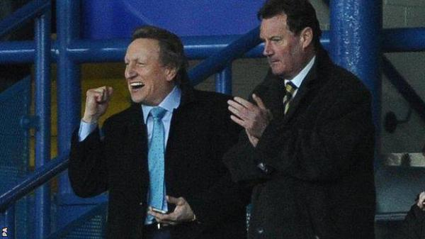 Neil Warnock celebrates Becchio's winner yesterday