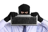 8711729-a-hacker-with-robbery-mask-holding-a-keyboard-isolated-on-white-background