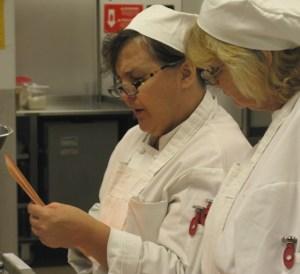 Chefs confer over a recipe