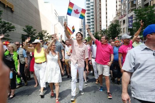 Walking in the Toronto Pride parade, Prime Minister Justin Trudeau was accompanied by Ontario Premier Kathleen Wynne, the first openly gay elected Premier in the country, and Toronto Mayor John Tory.
