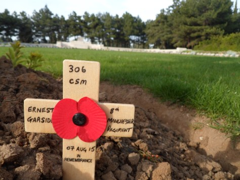 Commemorative Poppy & Cross left by Wayne Taylor