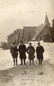 Frank in uniform outside North Road School in February 1916 following heavy snow (other people unknown)