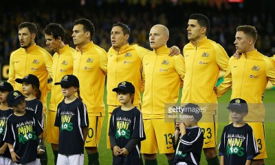 MELBOURNE, AUSTRALIA - JUNE 07: Trent Sainsbury, Mark Milligan, Tomas Rogic and Aaron Mooy of the Socceroos look on during the national anthems during the International Friendly match between the Australian Socceroos and Greece at Etihad Stadium on June 7, 2016 in Melbourne, Australia. (Photo by Scott Barbour/Getty Images)