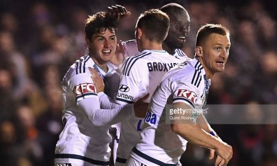 MELBOURNE, AUSTRALIA - SEPTEMBER 27: Marco Rojas of the Victory is congratulated by team mates after scoring a goal during the FFA Cup match between Bentleigh Greens and Melbourne Victory at Kingston Heath Soccer Complex on September 27, 2016 in Melbourne, Australia. (Photo by Quinn Rooney/Getty Images)