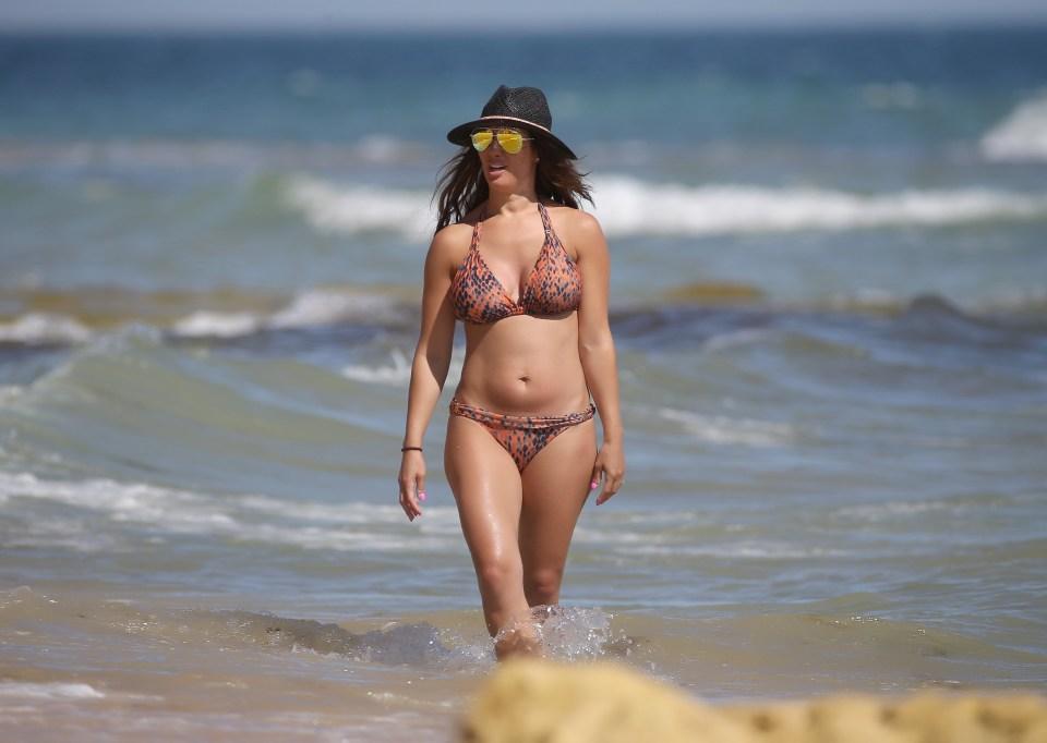 Rebekah Vardy strolls along the beachfront