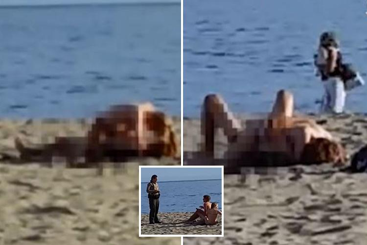 Brazen moment beachgoers are caught having sex on public beach in     Brazen moment beachgoers are caught having sex on public beach in California