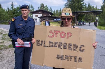 A woman protests at the 2015 Bilderberg meeting in Austria