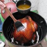 "Basting the turkey with the ""Super Smoking Sauce"""