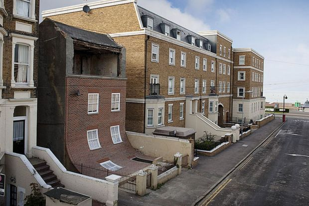 Sliding building: This derelict building actually looks like it is sliding into the street but is in fact a work of art by Alex Chinneck.