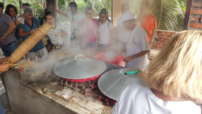 Cooking the Rice Paper for Rice Noodles at the Mekong Delta