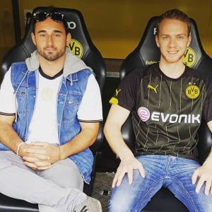 Visiting the Dortmund stadium in Germany with my scuba buddy from Thailand!