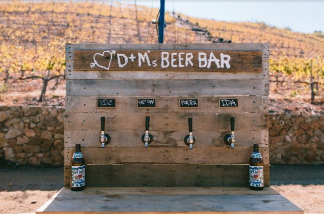 Calling all beer-loving brides and grooms! Goodbye fussy cocktail bars —hello rustic beer bars. Photo by: The Melideos