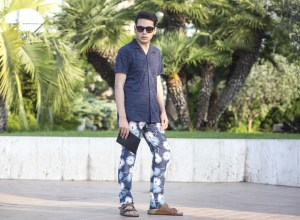 Menswear Fashion Blogger Ronan Summers in Monte Carlo wearing the Maison Valentino SS15 fiori explosion print trousers, hackett bag and modelling by the Casino garden
