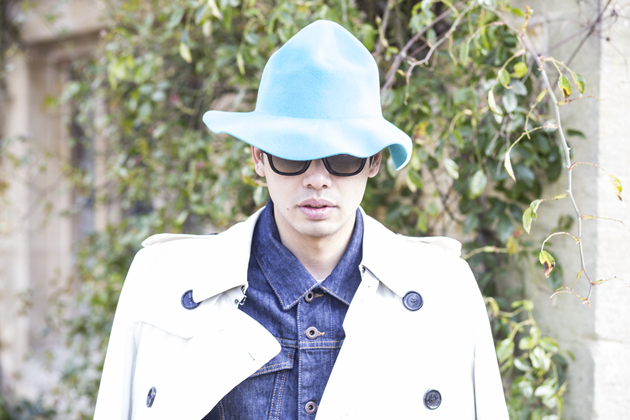Close up of Menswear blogger Ronan Summers wearing the Prorsum SS15 rabbit felt hat in Cyan