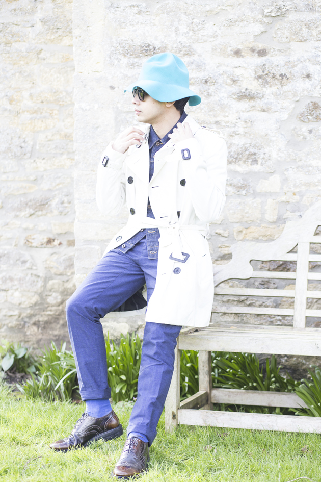 Fashion blogger Ronan Summers styles a mid-length Burberry London white trench coat and a denim jacket like in the SS15 show, and wears a rabbit felt bucket hat and a pair of leather wingtip brogues with a thick sole