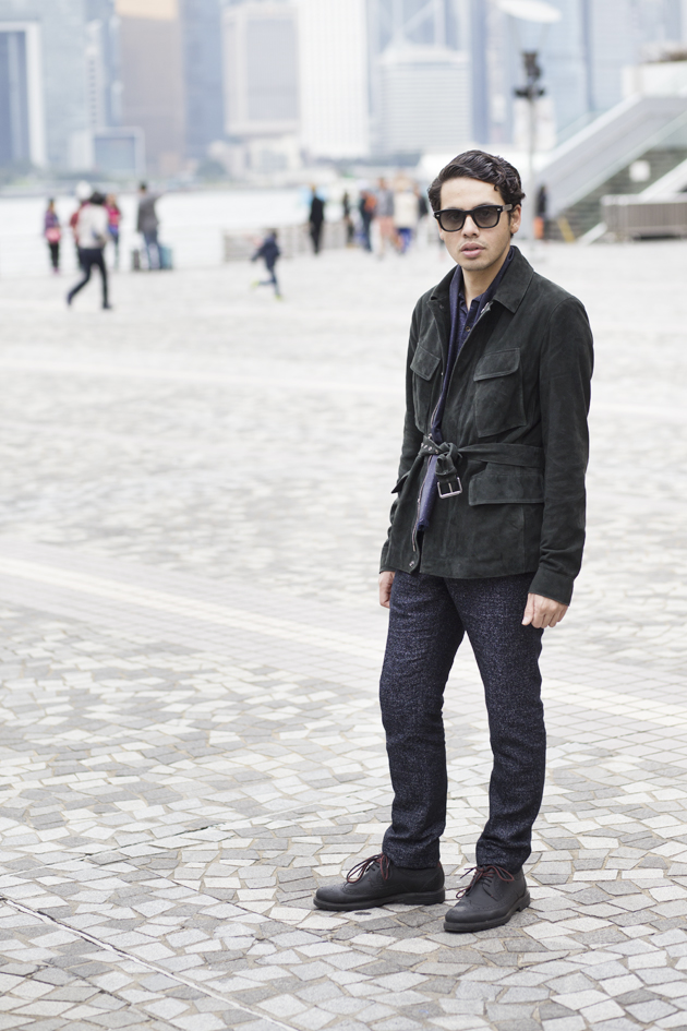 Blogger Ronan Summers has styled a Green Safari suede jacket by Reiss and posed near TST (Hong Kong)
