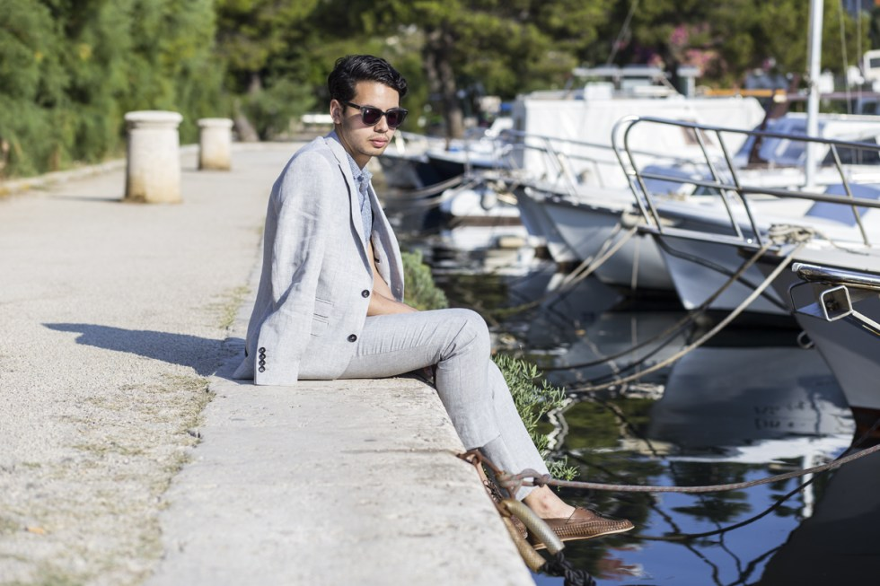 Fashion blogger Ronan Summers in Dubrovnik wearing a linen suit from Next