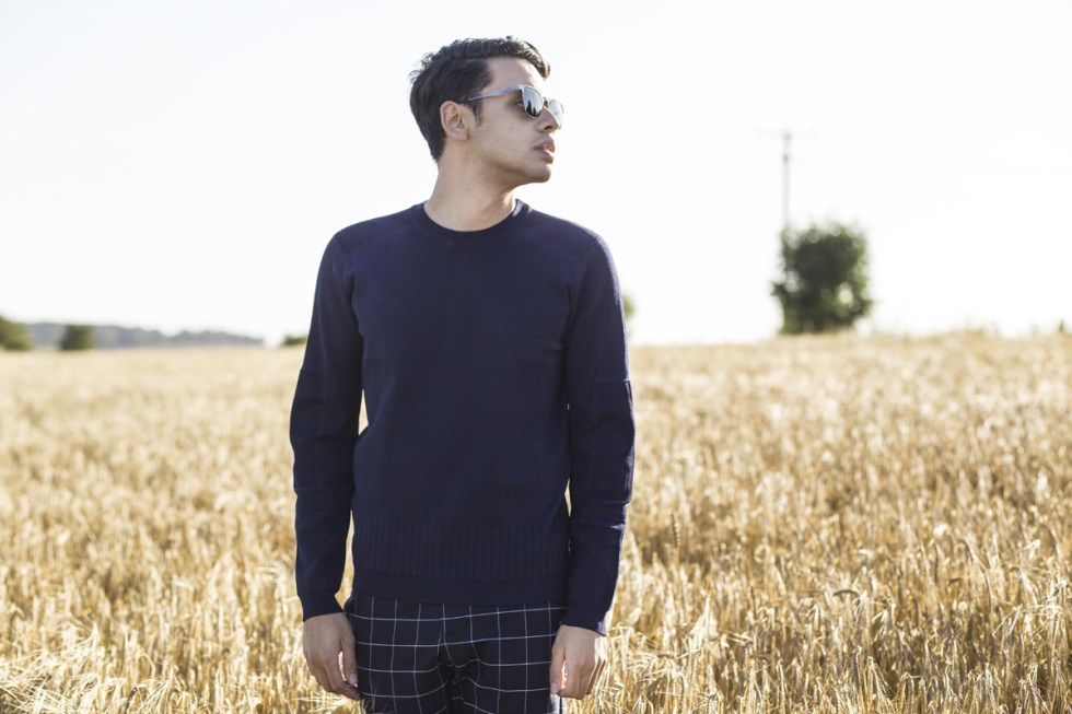 Mens blogger Ronan Summers posing by a Bali field wearing a Kenzo AW16 technical sweatshirt and TIJN eyewear sunglasses