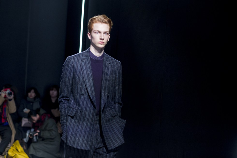 Model captured at Cerruti 1881 AW17 catwalk show in Paris wearing a pinstriped double breasted suit
