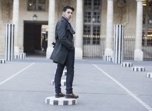 Ronan summers, menswear blogger attending the show in Paris, for fashion week, captured at Palais royal wearing Daks trench coat and car coat