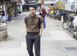 Menswear blogger Ronan shot in Cheung Chau wearing polo shirt Uniqlo and Next check tailored trousers