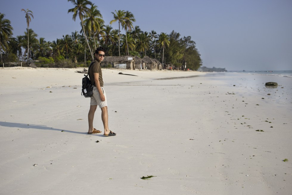 Ronan summers in Zanzibar wearing uniqlo and kenzo