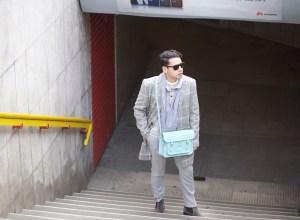 Ronan Summers wearing Cambridge satchel light blue bag, and kurt geiger suede chelsea boots