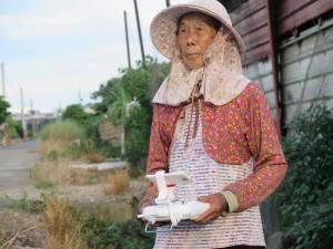 An 87 year-old farmer operates a drone as a bird-scare