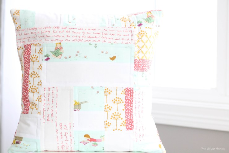 A scrappy quilted pillow cover for a little girl's bedroom.