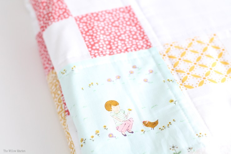 A throw quilt for a girl's room. Made with Aneela Hoey's Posy Fabric.