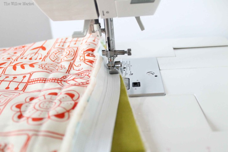 How to sew and install a zipper into a quilted pillow cover.