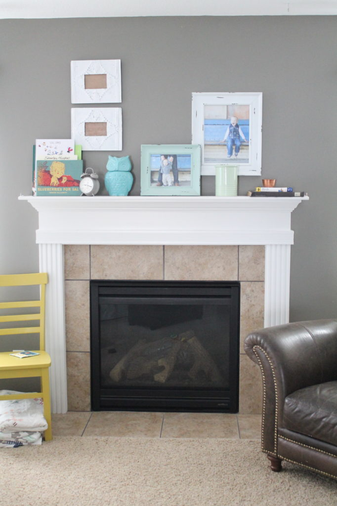Modern fire place mantle with shiplap and white subway tile.