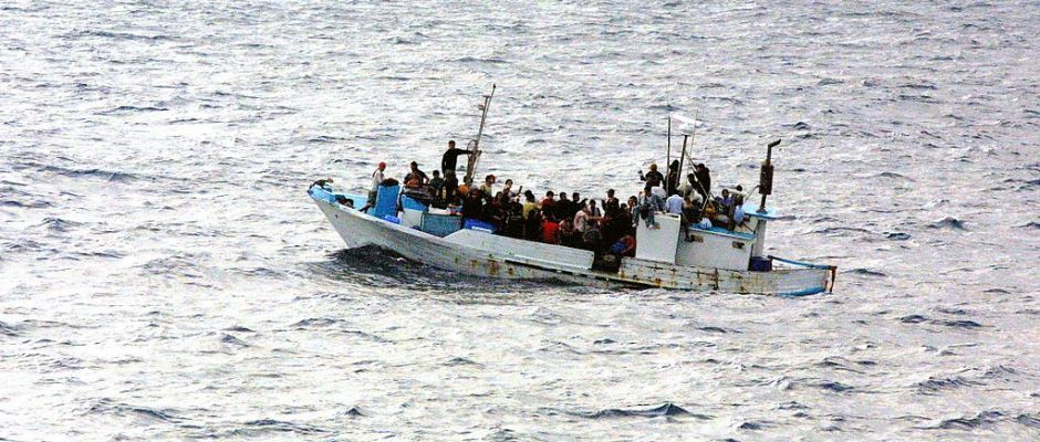 1024px-refugees_on_a_boatus-navy-photo