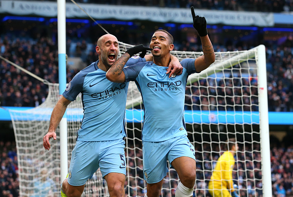 MANCHESTER, ENGLAND - FEBRUARY 05: Gabriel Jesus of Manchester City celebrates scoring his sides second goal with Pablo Zabaleta during the Premier League match between Manchester City and Swansea City at Etihad Stadium on February 5, 2017 in Manchester, England. (Photo by Alex Livesey/Getty Images)