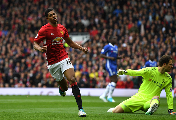MANCHESTER, ENGLAND - APRIL 16: Marcus Rashford of Manchester United celebrates scoring his sides first goal during the Premier League match between Manchester United and Chelsea at Old Trafford on April 16, 2017 in Manchester, England. (Photo by Shaun Botterill/Getty Images)