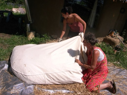 Stuffing the straw mattress