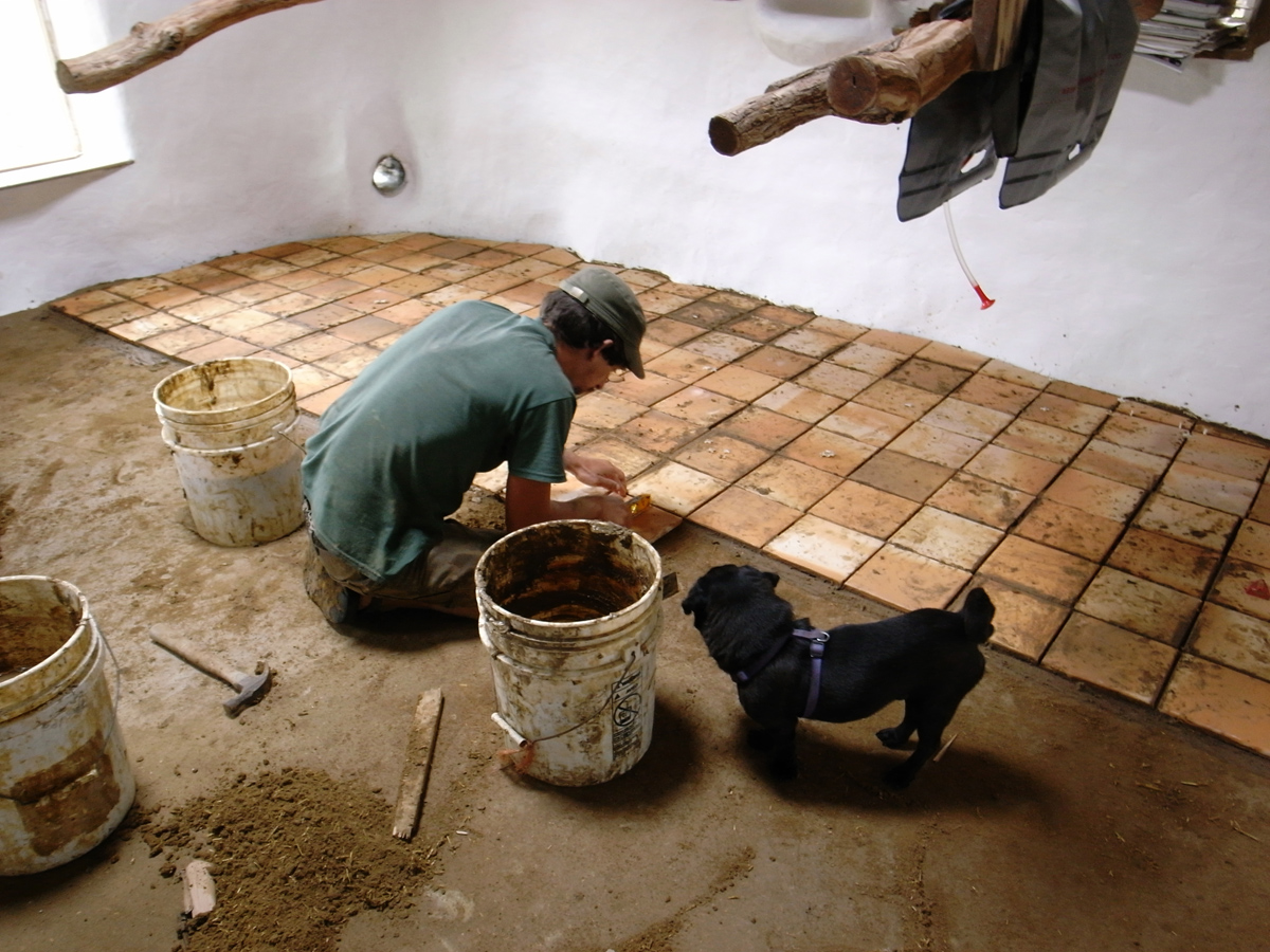 Cob house building timeline the year of mud laying terracotta tile dailygadgetfo Choice Image