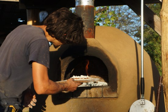 Outdoor Cob Oven: Loading Pizza