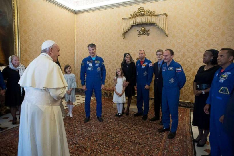 Pope Francis meets the crew members of the ISS 53 space mission during a private meeting at the Vatican June 8, 2018. Vatican Media/Handout via REUTERS.