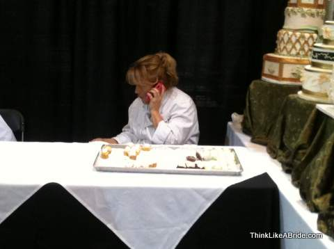 vendor talking on phone at bridal show