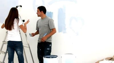 stock-footage-couple-painting-a-wall-blue