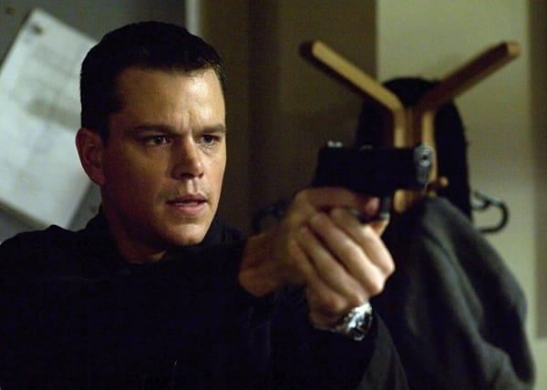 6 iconic Matt Damon roles - Jason Bourne, portrayed here holding a gun.