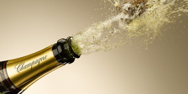 Champagne bottle being opened.