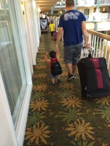 daddy and aj taking the luggage down