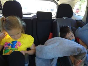 kiddos sleeping and entertaining themselves on a roadtrip