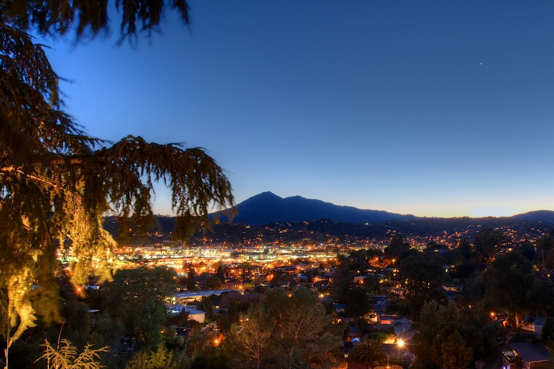 photo of Mt. Tamalpais at dusk with lights of San Rafael in the foreground