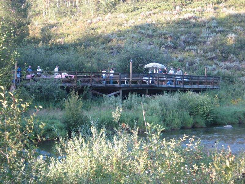 Our cook out deck on Robinson Creek, just steps away from your cabin.