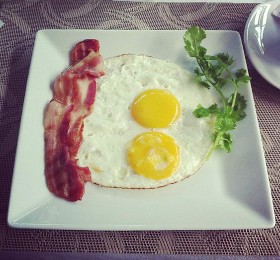 Hotel Breakfast Sunny Side Up Eggs and Bacon