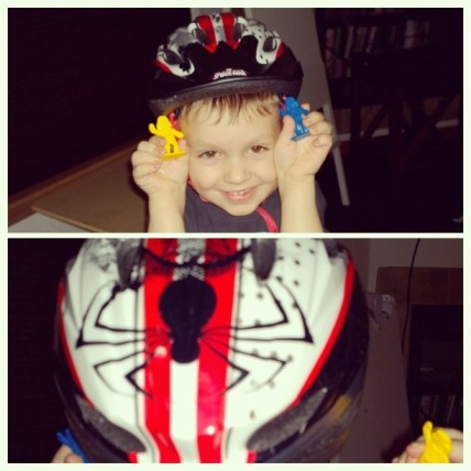 W in his Spider Man Helmet